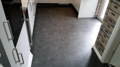 Screed and luxury vinyl tiles (Welsh slate) fitted.