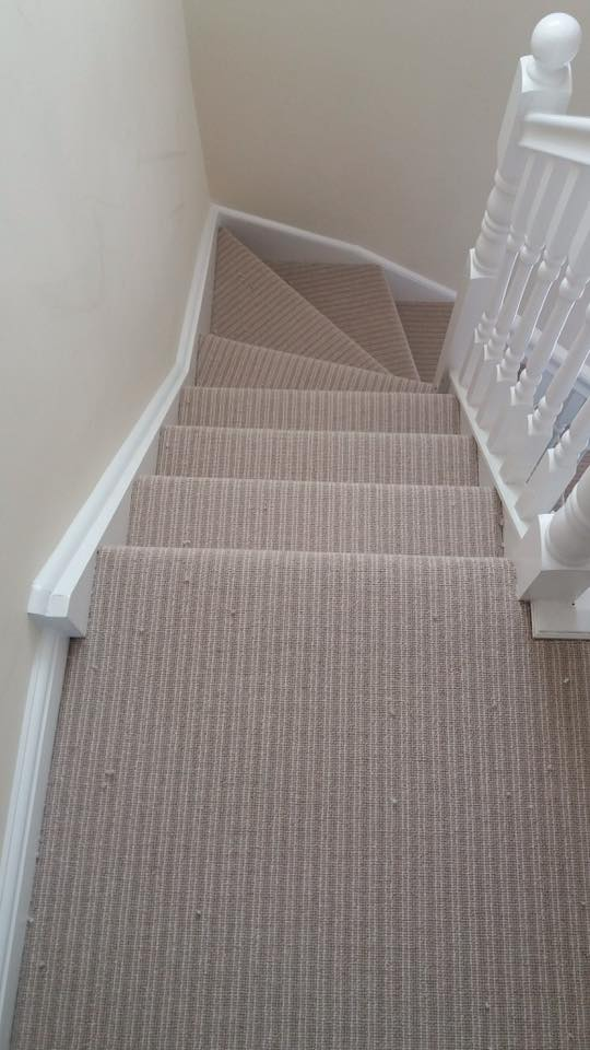 Hall stairs and landing stripe carpet fitting.