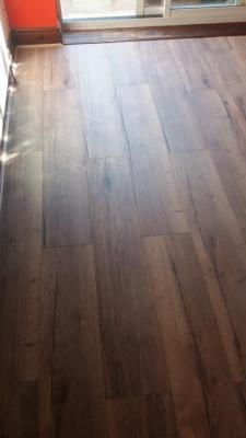 Wide board, real wood look laminate flooring.